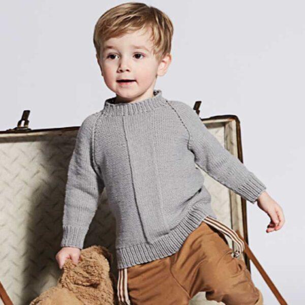 Drenge raglan sweater stående i en kuffert